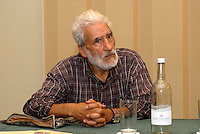 Hugo Blanco.Speaking at a fringe meeting organised by the.Green Left/ Socialist Resistance fringe during the .Green Party conference..Birmingham.England.11.09.10..Hugo Blanco is the historic leader of the Peruvian peasant movement, who has been actively campaigning for more than fifty years. A contemporary of Che Guevara, in the 1960s he played a central part in the 'Land or Death' peasant uprising in the southern highlands of Peru. He was captured, and sentenced to 25 years in prison. After an international campaign to free him Hugo was released from prison and expelled to Sweden in1976. After a lengthy exile living in Mexico he now resides again in Peru.. . The consistent struggles of the indigenous peoples of Latin America against neoliberalism and in defence of the environment are an inspiration to many ecosocialists across the world and this event, and other parts of Hugo's British tour, will give an opportunity to find out more including  the struggles in Peru which are less well known. . .Today Hugo Blanco is the editor of the Cusco based newspaper 'Lucha Indígena', and part of the purpose of this tour is to raise funds for this publication. The indigenous organisation 'Aidesep' has been in intense conflict with the neo-liberal Peruvian government for several years, fighting to prevent the Amazon rainforest from being sold to oil and gas corporations. In 2009 Peruvian military police massacred an unknown number of indigenous activists at Bagua, Hugo Blanco will report on this struggle and the wider struggles of indigenous people in Latin America...