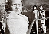 NEW ZEALAND, girls standing on pier, Lake Waikatipu, Queenstown (B&W)