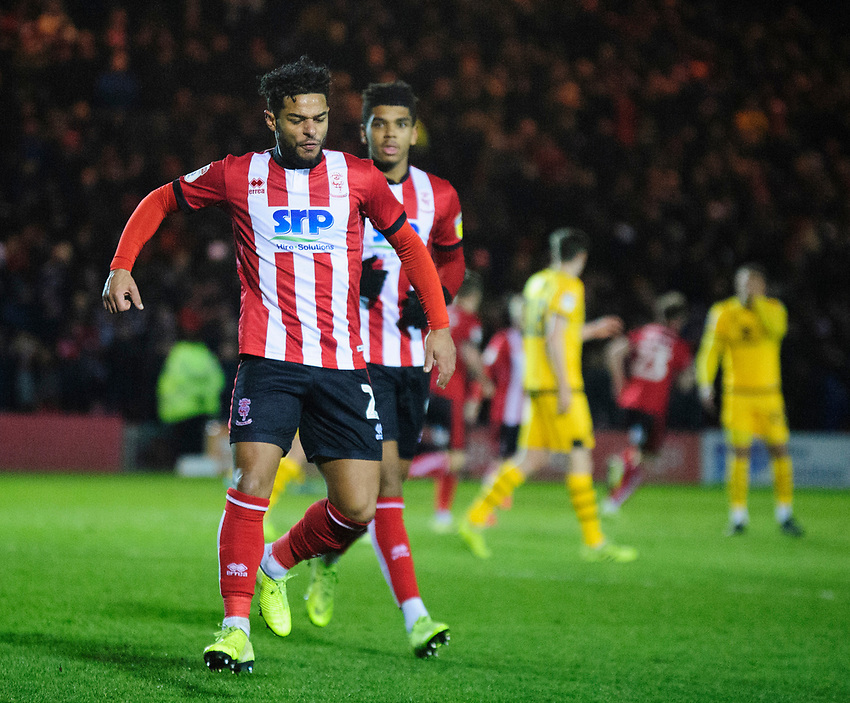 Lincoln City's Liam Bridcutt celebrates scoring his side's equalising goal to make the score 1-1, with team-mate Tyreece John-Jules<br /> <br /> Photographer Andrew Vaughan/CameraSport<br /> <br /> The EFL Sky Bet League One - Lincoln City v Milton Keynes Dons - Tuesday 11th February 2020 - LNER Stadium - Lincoln<br /> <br /> World Copyright © 2020 CameraSport. All rights reserved. 43 Linden Ave. Countesthorpe. Leicester. England. LE8 5PG - Tel: +44 (0) 116 277 4147 - admin@camerasport.com - www.camerasport.com