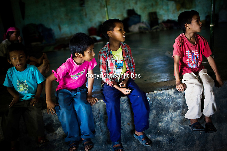 Children from different families were victims of communal violence. Families from the Mabauram village whose houses were burnt by suspected Dimasa group now have taken shelter in Zeme cultural hall in Lodi village in Upper Haflong. Ethnic clashes are regularly taking place between Zeme Nagas and the Dimasa tribe in North Cachar Hills in Assam, India.