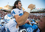 North Carolina team hoists kicker Nick Weiler on their shoulders after Weiler kicked the game winning 54 yard field goal against Florida State as time expired in an NCAA college football game in Tallahassee, Fla., Saturday, Oct. 1, 2016. North Carolina defeated Florida State 37-35 on a field goal. (AP Photo/Mark Wallheiser)