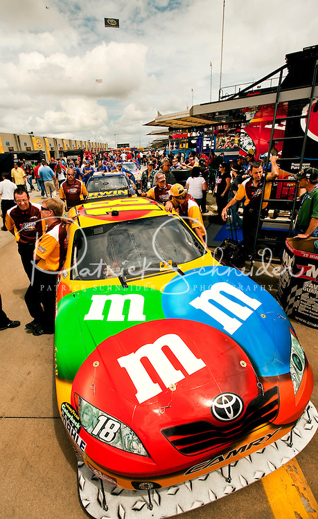 Team members for the No. 18 M&M/Interstate Batteries Toyota Camry, driven by NASCAR driver Kyle Busch for Joe Gibbs Racing, wait for the start of the 2009 Coca-Cola Classic 600 race at the Lowe's Motor Speedway, in Concord, NC. NASCAR Driver David Reutimann ultimately won the race, and his first Sprint Cup, during the rain-shortened event, held May 25, 2009. NASCAR's longest scheduled race went only 227 laps, or 340.5 miles, before officials ended it because of rain. The 2009 race was the 50th running of the Coca-Cola 600. Ryan Newman and Robby Gordon finished second and third respectively.