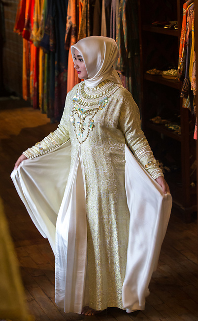 23 JAN, 2018, Jakarta, Indonesia: Indonesian fashion designer and icon, Dian Pelangi (27) showing off one of her detailed gowns at her workshop and retail outlet in the suburb of Kemang. She is discussing the rise of Islamic fashion and the massive revenue boost the sector is bringing to the Indonesian economy and individual designers and industry as a whole. Pictured in Jakarta by Graham Crouch for Luzerner Zeitung