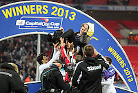 Pictured: Swansea players lift up manager Michael Laudrup. Sunday 24 February 2013<br /> Re: Capital One Cup football final, Swansea v Bradford at the Wembley Stadium in London.