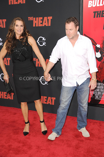 WWW.ACEPIXS.COM<br /> June 23, 2013...New York City <br /> <br /> Brooke Shields and Chris Henchy attending 'The Heat' New York Premiere at the Ziegfeld Theatre on June 23, 2013 in New York City.<br /> <br /> Please byline: Kristin Callahan... ACE<br /> Ace Pictures, Inc: ..tel: (212) 243 8787 or (646) 769 0430..e-mail: info@acepixs.com..web: http://www.acepixs.com