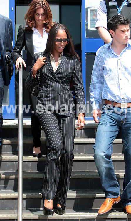 **ALL ROUND PICTURES FROM SOLARPIX.COM**.**NO UK NEWSPAPER PUBLICATION **UK MAGAZINE & SUPPLEMENT PUBLICATION ONLY** AND NO PUBLICATION IN FRANCE, SCANDINAVIA, AUSTRALIA AND GERMANY** .Super model Naomi Campbell leaves Heathrow Airport police station this afternoon after being charged with three counts of assaulting a police officer over an alleged air rage incident at Heathrow..She was also charged with disorderly conduct, and threatening behaviour towards a cabin crew member and will  appear in court next month..She was arrested on a British Airway plane last month after one of her bags apparently went missing at Terminal 5...JOB REF:6528- SFE       DATE:29_05_08 .**MUST CREDIT SOLARPIX.COM OR DOUBLE FEE WILL BE CHARGED* *UNDER NO CIRCUMSTANCES IS THIS IMAGE TO BE REPRODUCED FOR ANY ONLINE EDITION WITHOUT PRIOR PERMISSION*