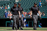 Umpires Darius Ghani, Andrew Barrett, and Brian Walsh before a Texas League game between the Amarillo Sod Poodles and Frisco RoughRiders on May 19, 2019 at Dr Pepper Ballpark in Frisco, Texas.  (Mike Augustin/Four Seam Images)
