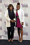 Patti LaBelle with singer Ledisi (Ledisi Anibade Young) at the 2011 Essence Music Festival on July 2, 2011 in New Orleans, Louisiana at the Louisiana Superdome.