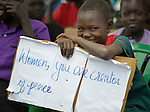 A girl holds a sign at a church-sponsored women's peace rally in Juba, South Sudan.