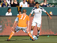 LA Galaxy defender Sean Franklin (28) attempts to move past Houston Dynamo defender Andrew Hainault (31). The LA Galaxy defeated the Houston Dynamo 4-1 at Home Depot Center stadium in Carson, California on Saturday evening June 5, 2010..