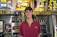 Young person serving meals in a fast food restaurant. This image may only be used to portray the subject in a positive manner..©shoutpictures.com..john@shoutpictures.com