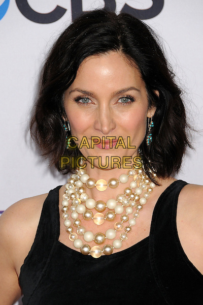 Carrie-Anne Moss.People's Choice Awards 2013 - Arrivals held at Nokia Theatre L.A. Live, Los Angeles, California, USA..January 9th, 2013.headshot portrait black sleeveless pearls necklace .CAP/ADM/BP.©Byron Purvis/AdMedia/Capital Pictures.