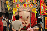 Bao-Jhong Yi-min Temple, Kaohsiung -- A 'Divine Pig' at display during Ghost Month.