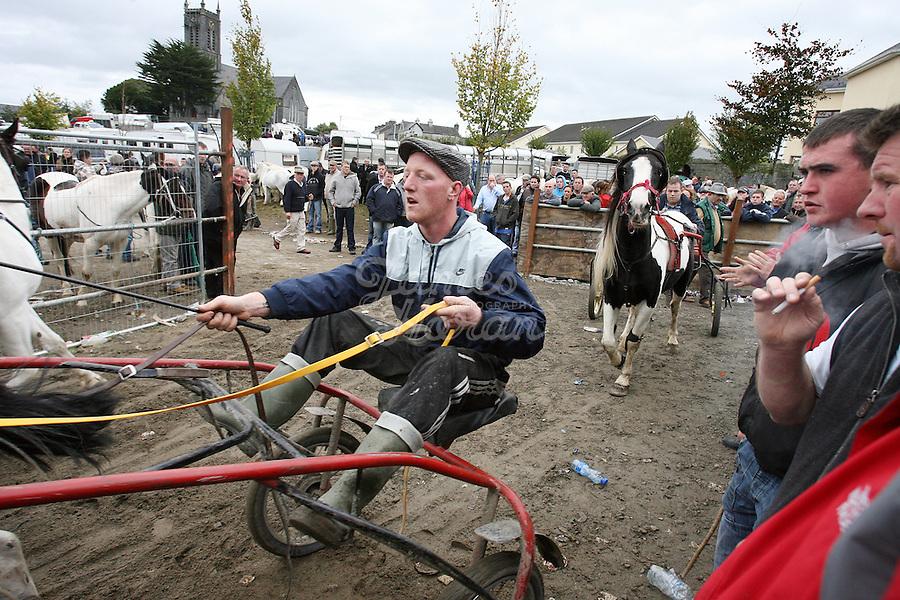 4/10/2010.  Riders in the trotting lane at the Ballinasloe Horse Fair, Ballinasloe, Ireland. Picture James Horan