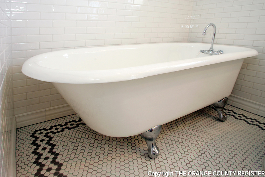 When the current owners of this Seal Beach Craftsman style tore down and rebuilt their 1906 house from the ground up, they kept a few  things from the original house.  This clawfoot tub is from the original 1906 house.<br />