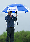 World number one, Luke Donald shelters from the rain on the 9th green during the pro-am ahead of the Barclays Scottish Open, played over the links at Castle Stuart, Inverness, Scotland from 7th to 10th July 2011:  Picture Stuart Adams /www.golffile.ie  6thJuly 2011