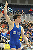 John Colletti of Long Beach raises his arm after beating Andre Cunha of East Meadow by decision 3-2 at 138 pounds in the Nassau County Division 1 wrestling quarterfinals at Hofstra University on Saturday, Feb. 13, 2016.