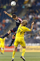 New England Revolution midfielder Kelyn Rowe (11) and Columbus Crew defender Chad Marshall (14) battle for head ball. In a Major League Soccer (MLS) match, the New England Revolution defeated Columbus Crew, 2-0, at Gillette Stadium on September 5, 2012.
