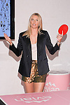 "Maria Sharapova plays table tennis during the Evian ""Live Young"" photo shoot event hosted by Maria Sharapova at Openhouse Gallery on August 24, 2010."