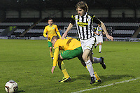 Kieran Doran goes past John Herron in the St Mirren v Celtic Scottish Professional Football League Under 20 match played at St Mirren Park, Paisley on 30.4.14.