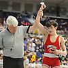 Referee Roy Scott raises the arm of Danny Colondona of Connetquot after he rallied from a late 2-0 deficit against Devin Marino of West Islip to win the 113 pound match 5-2 in the Suffolk County Division 1 wrestling quarterfinals at Hofstra University on Friday, Feb. 12, 2016.