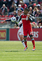 02 April 2011: Chivas USA midfielder Ben Zemanski #21 and Toronto FC forward Maicon Santos #29 in action during an MLS game between Chivas USA and the Toronto FC at BMO Field in Toronto, Ontario Canada..The game ended in a 1-1 draw...