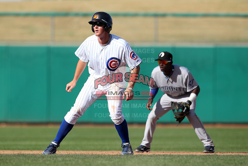 Mesa Solar Sox infielder D.J. LeMahieu #7 leads off in front of Adeiny Hechavarria during an Arizona Fall League game against the Phoenix Desert Dogs at HoHoKam Park on November 3, 2011 in Mesa, Arizona.  Mesa defeated Phoenix 8-7.  (Mike Janes/Four Seam Images)