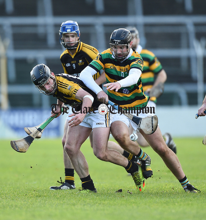 Patjoe Connolly of Ballyea in action against Dean Brosnan of Glen Rovers during their Munster Club hurling final at Thurles. Photograph by John Kelly.