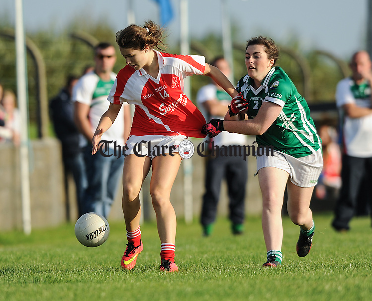 Fiona Neylon of Eire Og in action against Suzie Williams of Kilrush during their Junior Football county final at Doonbeg. Photograph by John Kelly.