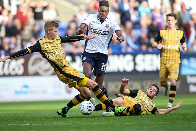 Bolton Wanderers'  Sammy Ameobi competing with Sheffield Wednesday's Sam Hutchinson and Sheffield Wednesday's Joost van Aken <br /> <br /> Photographer Andrew Kearns/CameraSport<br /> <br /> The EFL Sky Bet Championship - Bolton Wanderers v Sheffield Wednesday - Saturday 14th October 2017 - Macron Stadium - Bolton<br /> <br /> World Copyright &copy; 2017 CameraSport. All rights reserved. 43 Linden Ave. Countesthorpe. Leicester. England. LE8 5PG - Tel: +44 (0) 116 277 4147 - admin@camerasport.com - www.camerasport.com