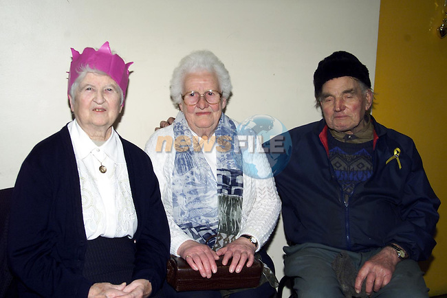 Madge Farland, Navan, M.McEneaney,Kingscourt and Francis Bull Ardee at the Ardee day care centres' christmass luncheon.