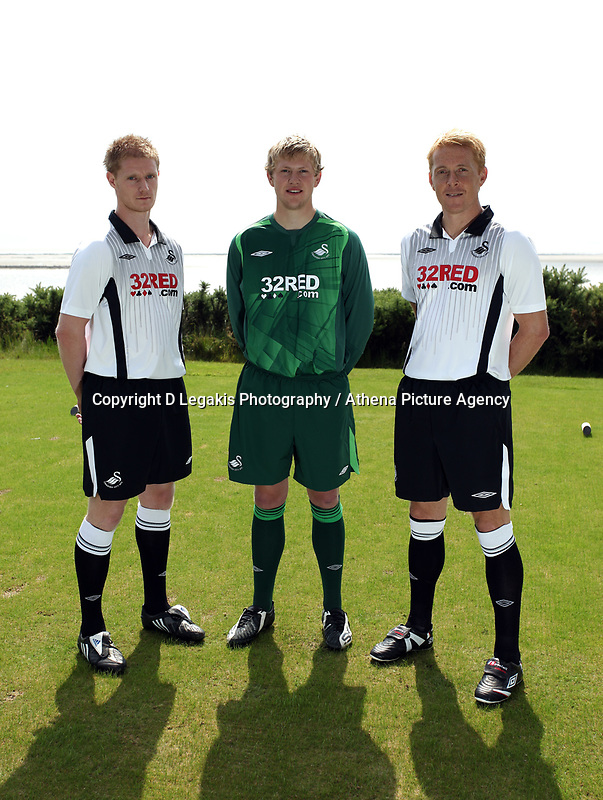 Pictured L-R: Alan Tate, unknown and Garry Monk<br /> Re: Swansea City Football Club new kit presentation at Machybys Golf Club near Llanelli west Wales. Tuesday 23 June 2009<br /> Picture by D Legakis Photography / Athena Picture Agency, 24 Belgrave Court, Swansea, SA1 4PY, 07815441513