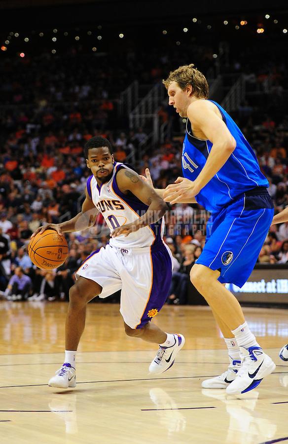 Mar. 27, 2011; Phoenix, AZ, USA; Phoenix Suns guard (0) Aaron Brooks drives to the basket against Dallas Mavericks forward (41) Dirk Nowitzki at the US Airways Center. The Maverick defeated the Suns 91-83. Mandatory Credit: Mark J. Rebilas-