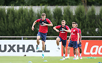 John Stones followed by Ben Gibson (Middlesbrough) of England during an open England football team training session at Stade Omnisport, Croissy sur Seine, France  on 12 June 2017 ahead of England's friendly International game against France on 13 June 2017. Photo by David Horn/PRiME Media Images.