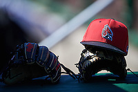 Ball State Cardinals hat and gloves sit in the dugout before a game against the Louisville Cardinals on February 19, 2017 at Spectrum Field in Clearwater, Florida.  Louisville defeated Ball State 10-4.  (Mike Janes/Four Seam Images)