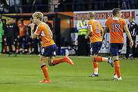 Cameron McGeehan of Luton Town (left) celebrates scoring the winning goal against Newport County during the Sky Bet League 2 match between Luton Town and Newport County at Kenilworth Road, Luton, England on 16 August 2016. Photo by David Horn.