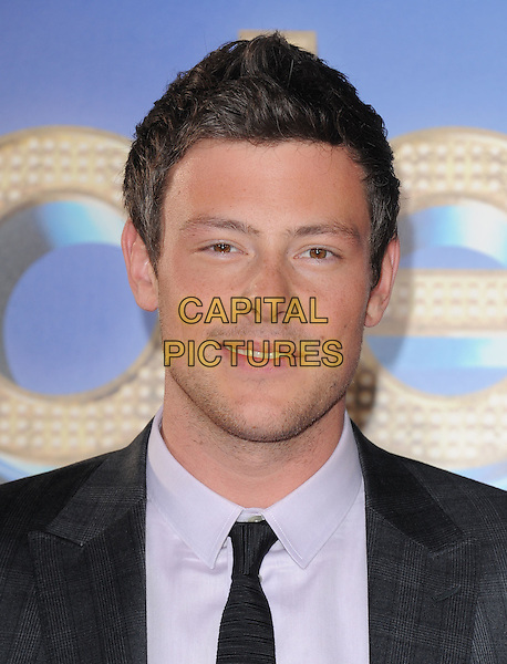 Cory Monteith .attends The 20th Century Fox 'Glee 3D' Concert World Movie Premiere held at The Regency Village theatre in Westwood, California, USA, .August 6th 2011..portrait headshot grey gray black tie smiling.CAP/RKE/DVS.©DVS/RockinExposures/Capital Pictures.