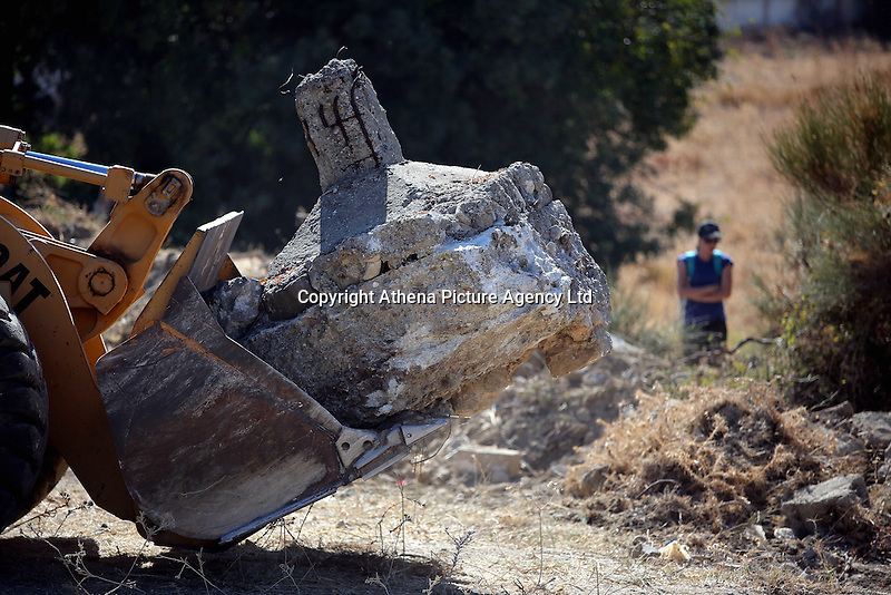 Pictured: A bulldozer moved pieces of discarded concrete from the new site of the search, where rubble was deposited from the farmhouse where Ben Needham disappeared from in Kos, Greece. Thursday 06 October 2016<br />Re: Police teams led by South Yorkshire Police, searching for missing toddler Ben Needham on the Greek island of Kos have moved to a new area in the field they are searching.<br />Ben, from Sheffield, was 21 months old when he disappeared on 24 July 1991 during a family holiday.<br />Digging has begun at a new site after a fresh line of inquiry suggested he could have been crushed by a digger.