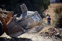 Pictured: A bulldozer moved pieces of discarded concrete from the new site of the search, where rubble was deposited from the farmhouse where Ben Needham disappeared from in Kos, Greece. Thursday 06 October 2016<br />