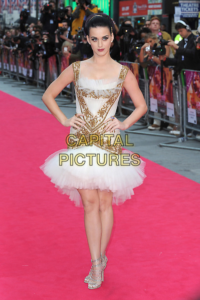 Katy Perry.'Katy Perry-Part of Me 3D' European Premiere, Empire Leicester Square, London, England..3rd July 2012.full length white gold embroidered dress tulle silver strappy sandals shoes hands on hips drop waist .CAP/BEL.©Tom Belcher/Capital Pictures.