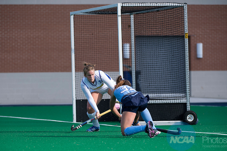 NORFOLK, VA - NOVEMBER 20:  Kayla Devlin (13) of the University of Delaware blocks a shot on goal by Marissa Creatore (33) of the University of North Carolina during the Division I Women's Field Hockey Championship held at the LR Hill Sports Complex on November 20, 2016 in Norfolk, Virginia.  Delaware defeated North Carolina 3-2 for the national title. (Photo by Jamie Schwaberow/NCAA Photos via Getty Images)