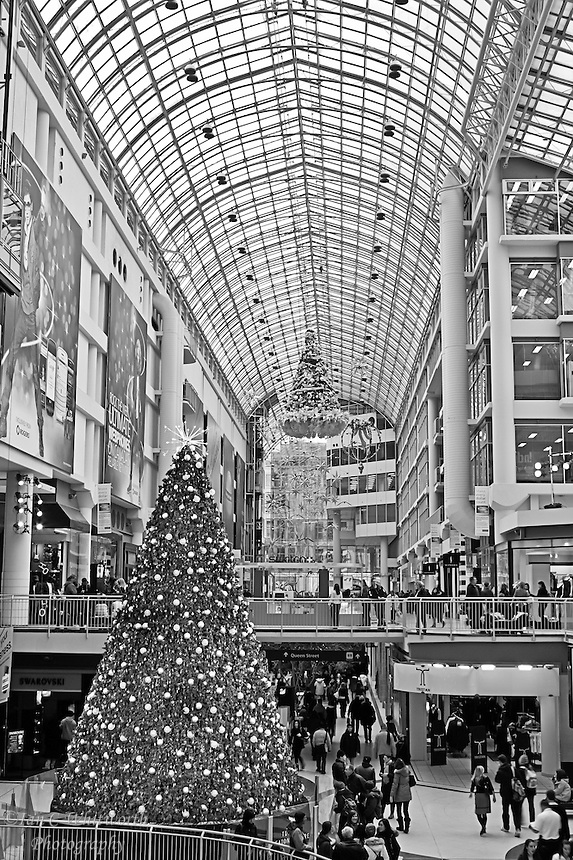 A black and white view inside the Eaton Centre at Christmas in Toronto