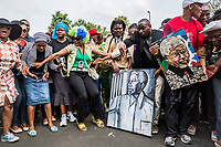 JOHANNESBURG, SOUTH AFRICA - DECEMBER 07: South Africans gather to pay respect and tribute to former President Nelson Mandela outside his Houghton home on December 7, 2013 in Johannesburg, South Africa. Mr Mandela, died on Thursday aged 95, spent 27 years in jail before becoming South Africa's first black president in 1994.<br /> Photo by Daniel Berehulak for The New York Times