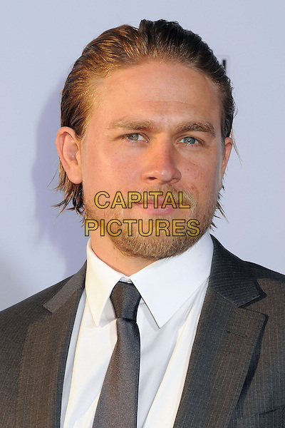 Charlie Hunnam<br /> &quot;Sons of Anarchy&quot; Season Six Premiere Screening held at the Dolby Theatre, Hollywood, California, USA, 7th September 2013.<br /> portrait headshot beard facial hair white shirt grey gray suit <br /> CAP/ADM/BP<br /> &copy;Byron Purvis/AdMedia/Capital Pictures