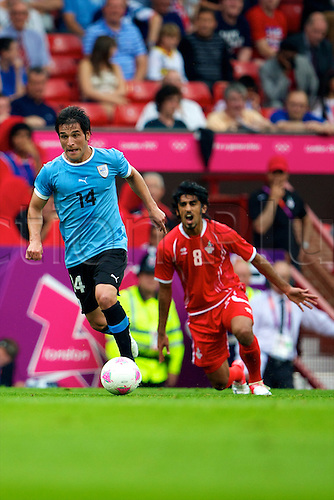 26.07.2012 Manchester, England. Uruguay midfielder Nicolás Lodeiro in action during the first round group A mens match between United Arab Emirates and Uruguay at Old Trafford.