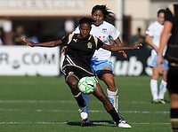 07 June 2009:  Formiga of the Gold Pride controls the ball away from Chioma Igwe of the Red Stars during the game at Buck Shaw Stadium in Santa Clara, California.   FC Gold Pride tied Chicago Red Stars, 1-1.