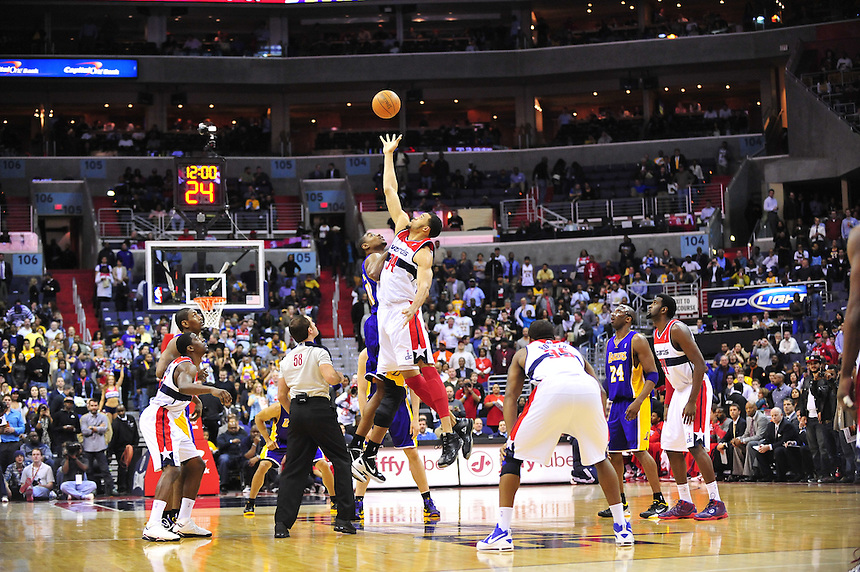 JaVale McGee of the Wizards gets the tip-over Andrew Bynum of the Lakers to start the game at the Verizon Center in Washington, D.C. on Wednesday, March 7, 2012. Alan P. Santos/DC Sports Box
