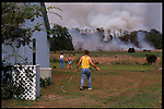 May 27, 2001. In Groveland residents ready their houses and property against wildfires. This backyard was just last year a lake, with fishing.