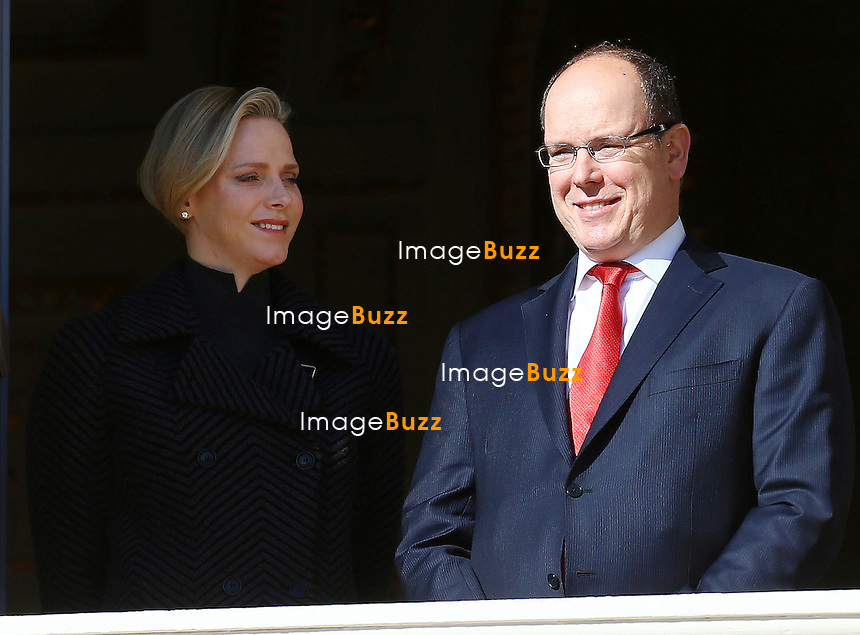 Prince Albert II of Monaco and Princess Charlene attend the Sainte Devote procession from the balcony of the Palace.<br /> Monaco, January 27, 2014.