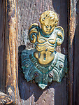Bronze angel door knob, architectural details, Venice, Italy